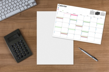 Calendar blank sheet and calculator on wooden Table