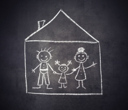 family and home are drawn with chalk on a blackboard