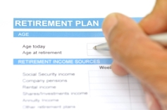 retirement plan document with pen